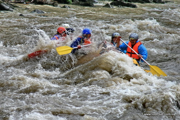 rafting in the Carpathians. In a rapid